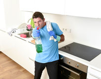 Young happy man holding washing detergent spray bottle as aiming with hand gun playful Stock Images