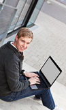 Young happy man with laptop Royalty Free Stock Image