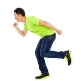 Young happy man make a running pose Royalty Free Stock Images
