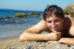 Young happy man near the sea Royalty Free Stock Photo