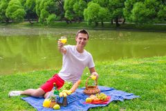 Young happy man picnicking and relaxing outdoors Royalty Free Stock Photography