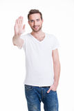 Young happy man requiring stop with his hand. Stock Photography