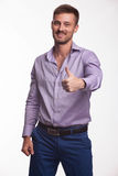 Young happy man showing by hands Royalty Free Stock Photography