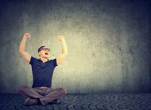 Cheerful man screaming happily with hands raised royalty free stock photo