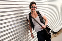 Young happy man smiling in urban background Stock Image