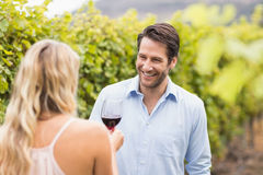 Young happy man smiling at woman Stock Image