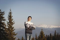 Young happy man standing on the top of mountain in snowy winter. Young happy man standing on the top of mountain in winter Royalty Free Stock Photography