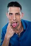 Young Happy Man Sticking Out Tongue Stock Image