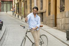 Young happy man taking selfie with mobile phone on retro cool vintage bike Stock Image