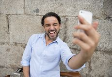 Young happy man taking selfie with mobile phone on retro cool vintage bike Stock Photo