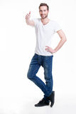 Young happy man with thumbs up sign in casuals. Stock Photos
