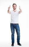 Young happy man with thumbs up sign in casuals. Stock Images
