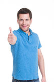 Young happy man with thumbs up sign in casuals Stock Images