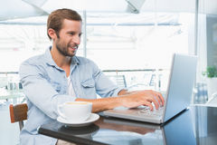 Young happy man typing on the laptop Stock Photo