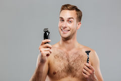 Young happy man what razor to choose Stock Images