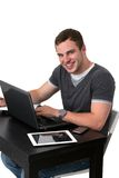 Young happy man working on pc Stock Photos