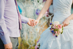 Young and happy married couple holding hands. Romance Stock Image