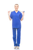 Young and happy medical worker in blue clothes Royalty Free Stock Image