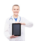 Young and happy medical worker holding an ipad Stock Images