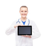 Young and happy medical worker holding a tablet computer Stock Photography