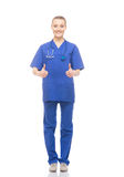 Young and happy medical worker holding thumbs up Stock Photos