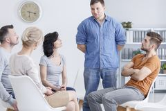 Man talking in support group Royalty Free Stock Image
