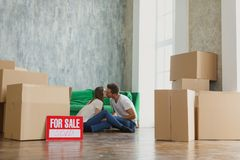 Young happy millennial couple students move into their first new owners home. Simple white background of urban apartment stock image