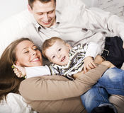 Young happy modern family smiling together at home. lifestyle people concept, father holding baby son Stock Photo