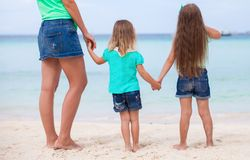 Young happy mother and adorable daughters at white Stock Photo