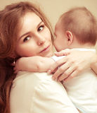 Young happy mother with baby Royalty Free Stock Photo