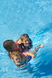 Young happy mother and children enjoying vacations Royalty Free Stock Image