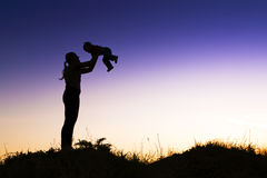 Young happy mother of children in the outdoors. Royalty Free Stock Images
