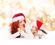 A young and happy mother and daughter on a Christmas background Stock Photography