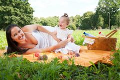 Young happy mother with daughter in the park Royalty Free Stock Photography
