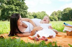 Young happy mother with daughter in the park Stock Images