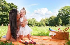 Young happy mother with daughter in park on picnic Stock Photography