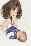 Young and Happy Mother Having Good Time Together with Her Baby I Stock Photo