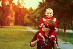 Young happy mother with her baby daughter Royalty Free Stock Photos