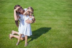 Young happy mother and her daughter having fun Stock Image