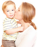 Young happy mother is kissing her child. Young happy mother is embracing and kissing her child. Isolated on white Royalty Free Stock Images