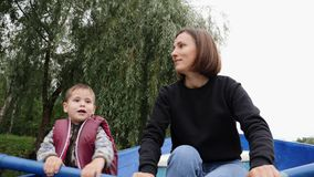 Young happy mother sailing on boat with her little son. Happy mother and son having fun outdoor. Lovely mom and her adorable littl. E son spending time together stock video footage