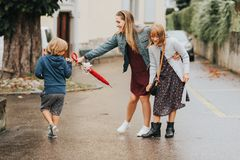 Two Funny Kids And Umbrella Summer Rain Stock Image