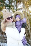 Young happy mother walking with her little daughter Royalty Free Stock Photography