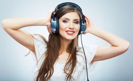 Young Happy Music woman isolated portrait. Female model studio Stock Images