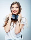 Young Happy Music woman isolated portrait. Female model studio Royalty Free Stock Image