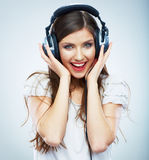 Young Happy Music woman isolated portrait. Female model studio Royalty Free Stock Photos