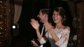 Young happy newlyweds couple clapping hands together. stock video footage