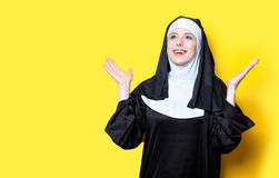 Young happy nun. On yellow background Stock Photography