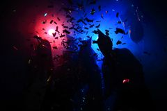 Young happy people are dancing in club. Nightlife and disco concept. stock photos