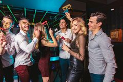 Happy people are dancing in club. Nightlife and disco concept stock photography